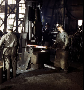 fsac.1a34709 Jack Delano March 1943 Working with a small steam drop hammer at the blacksmith shop in the Santa Fe R.R. shops, Topeka, Kansas