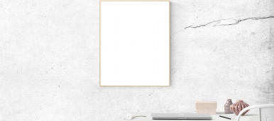 Blank picture frame above minimally styled desk.